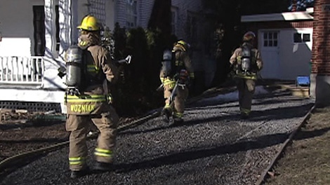 Firefighters respond to a blaze at a home on Julian Avenue in West Wellington, Thursday, April 7, 2011.