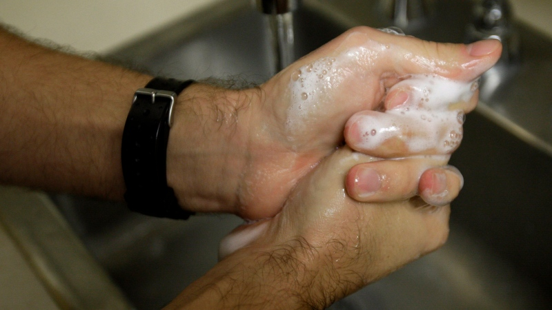 A man is shown washing his hands in this 2009 file photo. (AP Photo/Rob Carr)