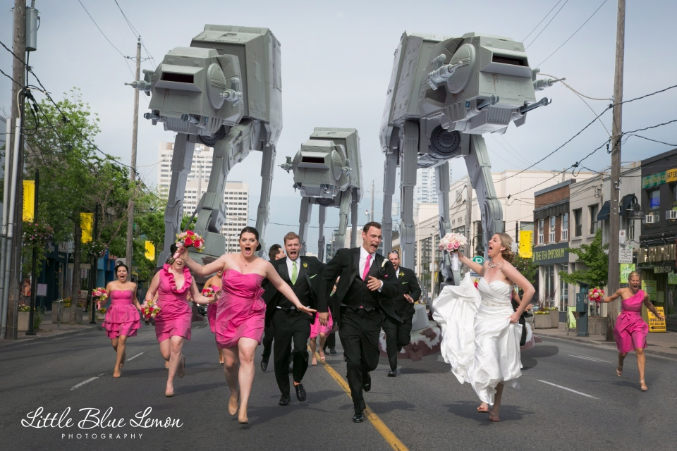 Leslie Seiler and Paul Kingston have had to curtail their own honeymoon to deal with the spate of publicity surrounding one of their wedding photos that depicts the two aspiring comedians and their wedding party being chased by the iconic All-Terrain Armored Transport vehicles  from the Star Wars franchise. (Little Blue Lemon Photography & Cinematography-Danielle & Tony Lombardo)
