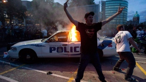 A police car burns during a riot in downtown Vancouver, Wednesday, June 15, 2011. (Geoff Howe / THE CANADIAN PRESS)