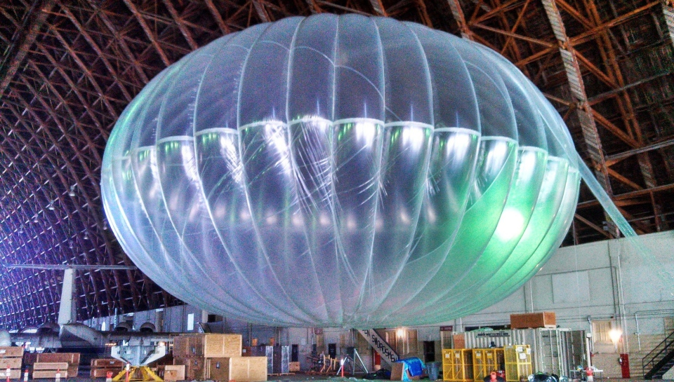 In this March 1, 2013 photo released by Google, a fully inflated test balloon sits in a hangar at Moffett Field airfield, Calif. (AP Photo/Google, Andrea Dunlap