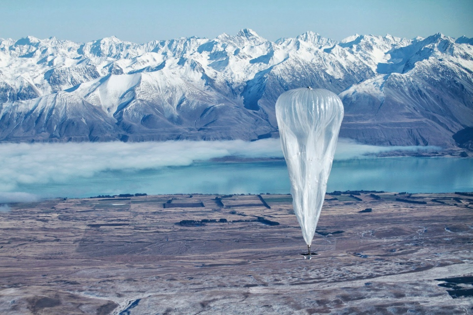 In this June 10, 2013 photo released by Jon Shenk, a Google balloon sails through the air with the Southern Alps mountains in the background, in Tekapo, New Zealand. (AP Photo/Jon Shenk)