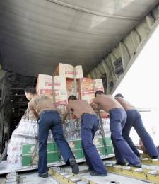 Thai soldiers load supplies for victims of a devastating cyclone in Burma onto a Thai military transport plane at the military airport in Bangkok, Thailand on Tuesday, May 6, 2008. (AP / Apichart Weerawong)