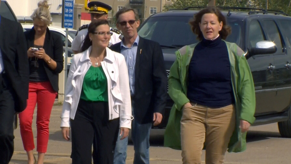 Mayor Melissa Blake was joined by Premier Alison Redford in Fort McMurray, where the premier toured an area where volunteers were filling sandbags Friday, June 14.