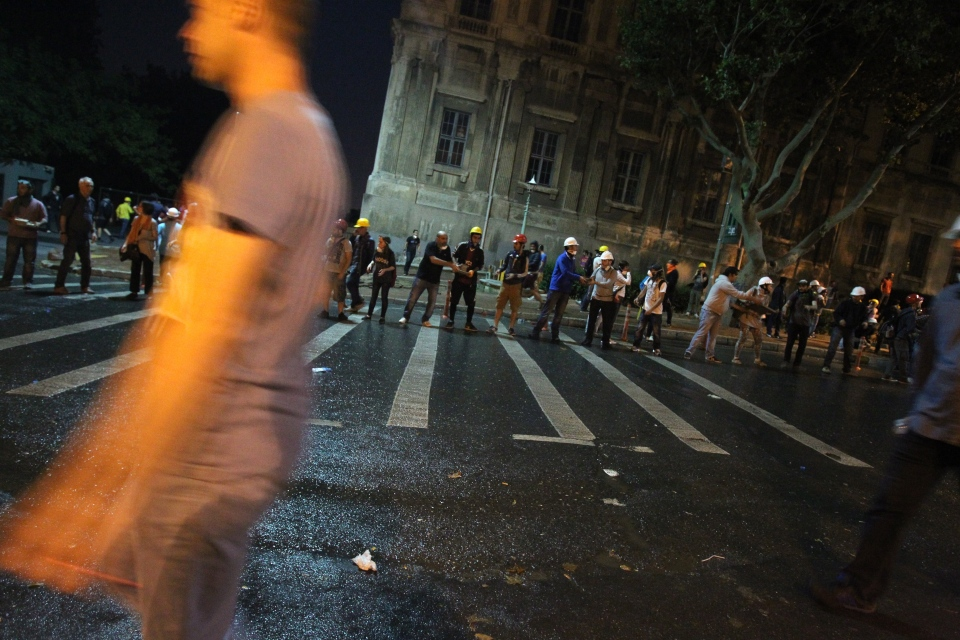 Protesters bring stones to make a barricade after a police operation that evacuated the Gezi Park in Istanbul, Saturday, June 15, 2013. (AP / Thanassis Stavrakis)