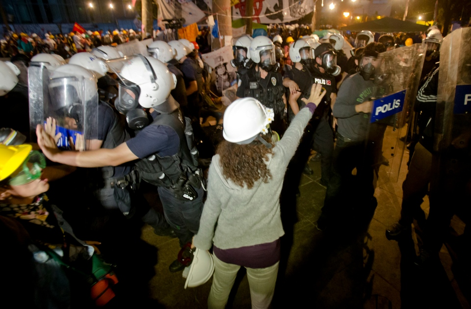 Protesters try to resist the advance of riot police in Gezi Park in Istanbul, Turkey, Saturday, June 15, 2013. (AP / Vadim Ghirda)
