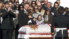 The casket bearing Cpl. Yannick Scherrer is carried out of the church following funeral services, as friends and family look on at CFB Valcartier, Friday April 8 2011. (Clement Allard / THE CANADIAN PRESS)