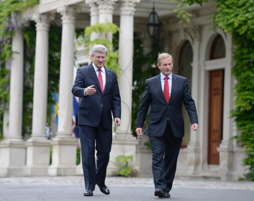 Prime Minister Stephen Harper and Irish Prime Minister Enda Kenny walk outside Farmleigh House in Dublin, Ireland, Sunday, June 16, 2013. (Adrian Wyld / THE CANADIAN PRESS)