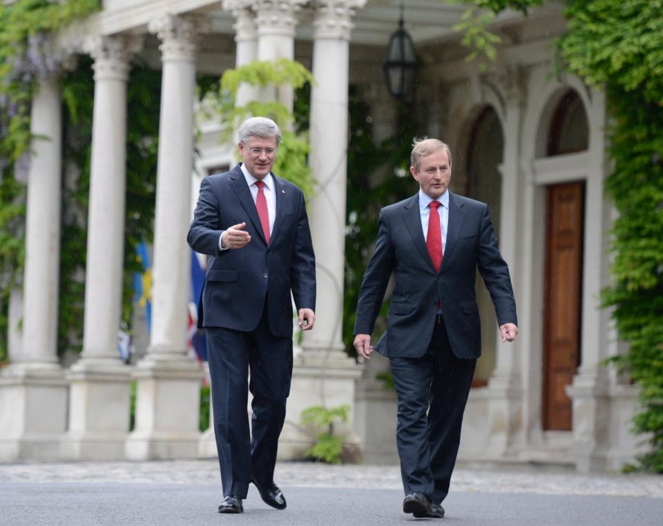 Prime Minister Stephen Harper and Irish Prime Minister Enda Kenny walk outside Farmleigh House in Dublin, Ireland, Sunday, June 16, 2013. (Adrian Wyld / THE CANADIAN PRESS)