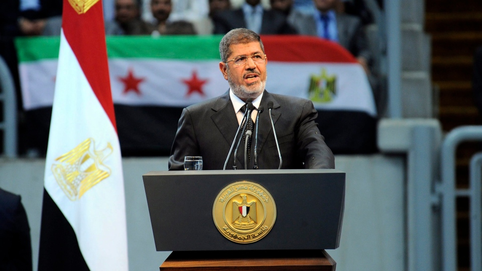In this image released by the Egyptian Presidency, Egyptian President Mohammed Morsi addresses a rally called for by hardline Islamists loyal to the Egyptian president to show solidarity with the people of Syria, in a stadium in Cairo, Egypt, Sunday, June 15, 2013. (AP / Egyptian Presidency)