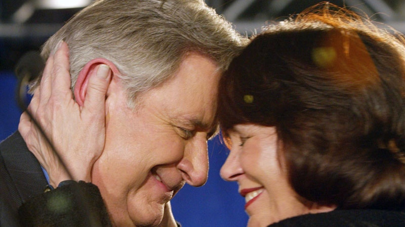 Alberta Premier Ralph Klein and his wife Colleen embrace at his campaign headquarters after winning a fourth consecutive majority government on Monday Nov. 22, 2004. (Frank Gunn / THE CANADIAN PRESS)