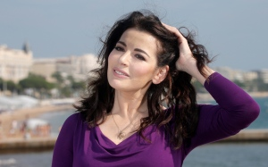 English food writer, journalist and broadcaster, Nigella Lawson poses during the 28th MIPCOM (International Film and Programme Market for TV, Video,Cable and Satellite) in Cannes, southeastern France, Tuesday, Oct. 9, 2012.  (AP / Lionel Cironneau)