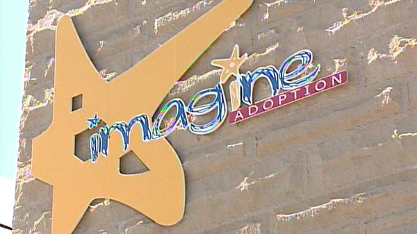 The sign for Imagine Adoption Inc. is seen in Cambridge, Ont. in July 2009.