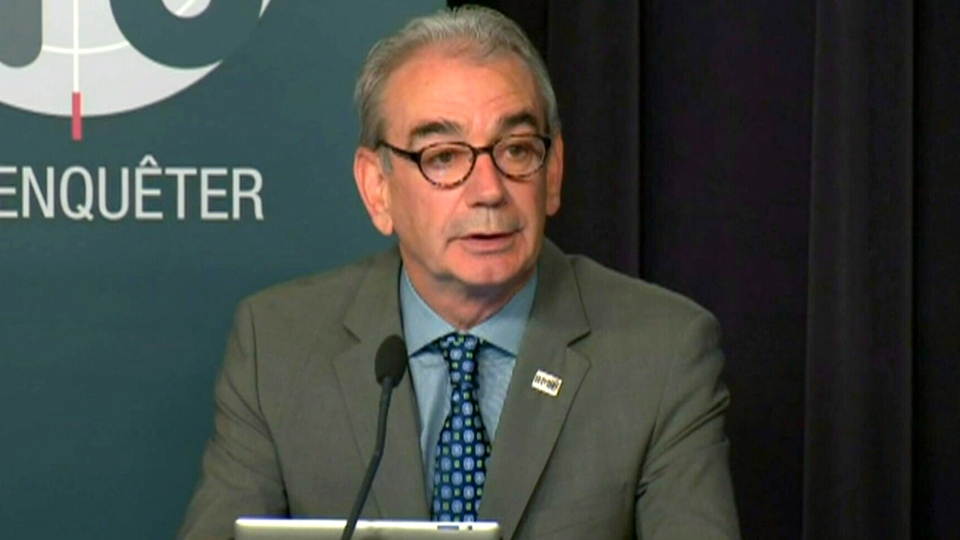 Anti-corruption unit commissioner Robert Lafreniere speaks during a press conference in Montreal, Monday, June 17, 2013.