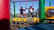 Siblings play in a playground