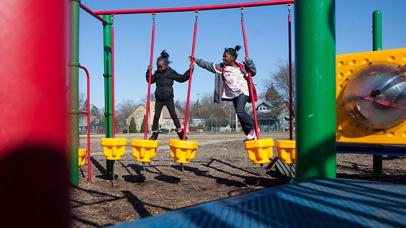 Kaya Braylock,6, and Erinn Louis,8, of Flint play on Milbourne Avenue's Park and Playground on Wednesday, April 3, 2013. (MLive.com / Sammy Jo Hester )