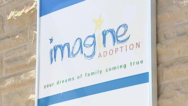 The sign for Imagine Adoption Inc. is seen in Cambridge, Ont. in this undated image taken from video.
