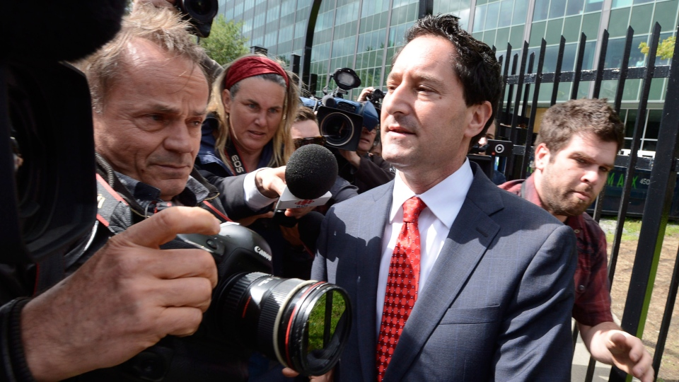 Montreal Mayor Michael Applebaum moves past members of the media outside police headquarters in Montreal, Monday, June 17, 2013. (Ryan Remiorz / THE CANADIAN PRESS)