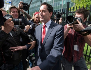 Montreal Mayor Michael Aplebaum makes his way through the media as he leaves police headquarters after being arrested on corruption charges Monday, June 17, 2013 in Montreal. (Ryan Remiorz / THE CANADIAN PRESS)