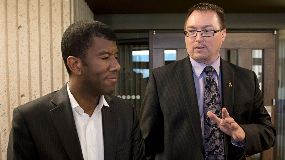 MLA Trevor Zinck, accompanied by his lawyer Lyle Howe, heads from Nova Scotia Supreme Court in Halifax on Monday, June 17, 2013. (Andrew Vaughan / THE CANADIAN PRESS)