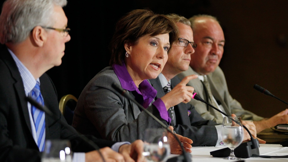 Manitoba Premier Greg Selinger, Saskatchewan Premier Brad Wall and Northwest Territories Premier Bob McLeod listen in as British Columbia Premier Christy Clark responds to media questions during the press conference for the 2013 Western Premiers' Conference in Winnipeg, Monday, June 17, 2013. (John Woods / THE CANADIAN PRESS)