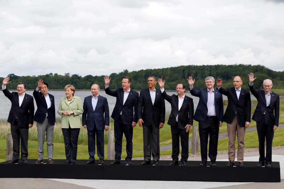 G8 leaders from left, European Commission President Jose Manuel Barroso, Japan's Prime Minister Shinzo Abe, German Chancellor Angela Merkel, Russian President Vladimir Putin, British Prime Minister David Cameron, U.S. President Barack Obama, French President Francois Hollande, Prime Minister Stephen Harper, Italian Prime Minister Enrico Letta and European Council President Herman Van Rompuy pose during a group photo opportunity during the G8 summit at the Lough Erne golf resort in Enniskillen, Northern Ireland, on Tuesday, June 18, 2013 (AP / Lefteris Pitarakis)