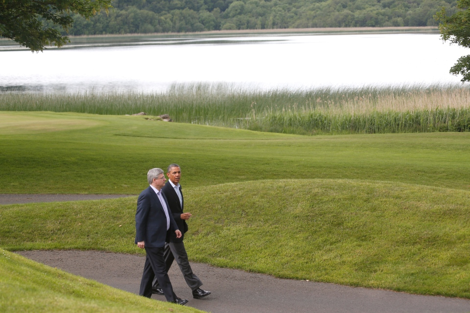 U.S. President Barack Obama and Prime Minister Stephen Harper walk together to a group photo opportunity during the G8 summit at the Lough Erne golf resort in Enniskillen, Northern Ireland, on Tuesday, June 18, 2013. (AP / Lefteris Pitarakis)