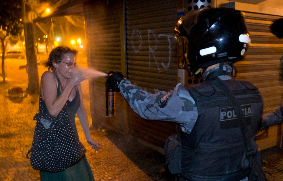 A military police pepper sprays a protester during a demonstration in Rio de Janeiro, Brazil, Monday, June 17, 2013. (AP / Victor R. Caivano)