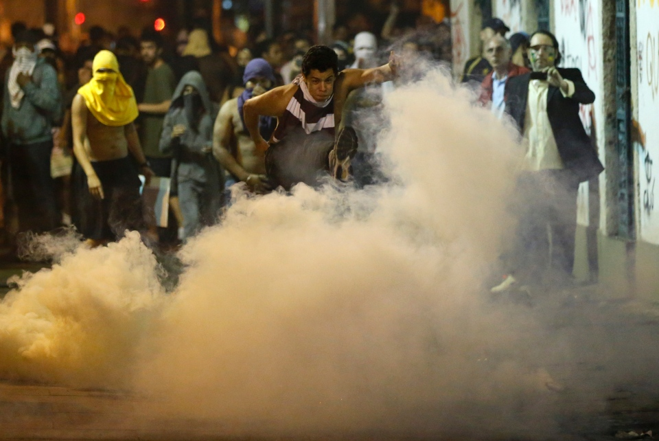 A protester kicks a gas canister during a demonstration a in Rio de Janeiro, Brazil, Monday, June 17, 2013. (AP / Victor R. Caivano)