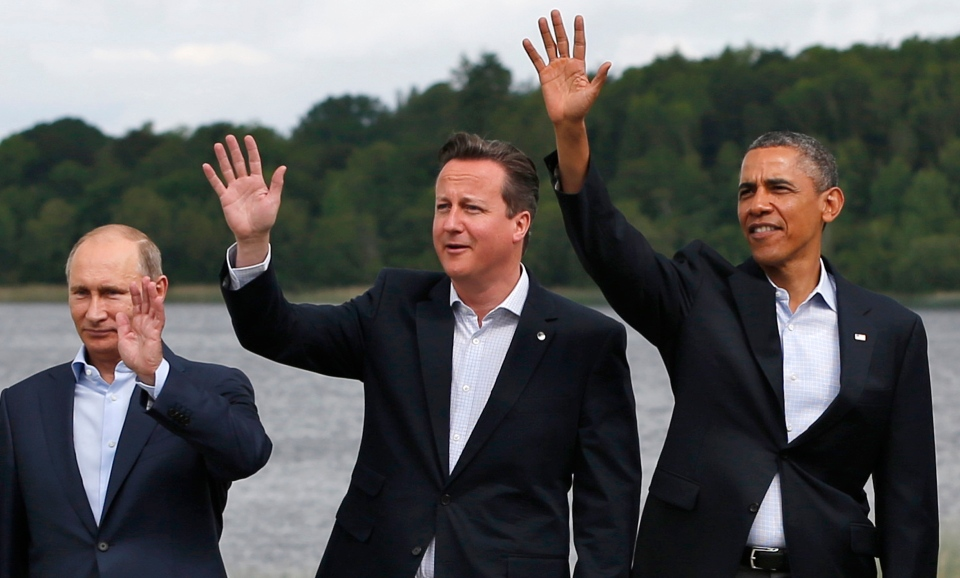 G8 leaders from left, Russian President Vladimir Putin, British Prime Minister David Cameron and US President Barack Obama at the Lough Erne golf resort in Enniskillen, Northern Ireland, on Tuesday, June 18, 2013. (AP Photo/Lefteris Pitarakis)