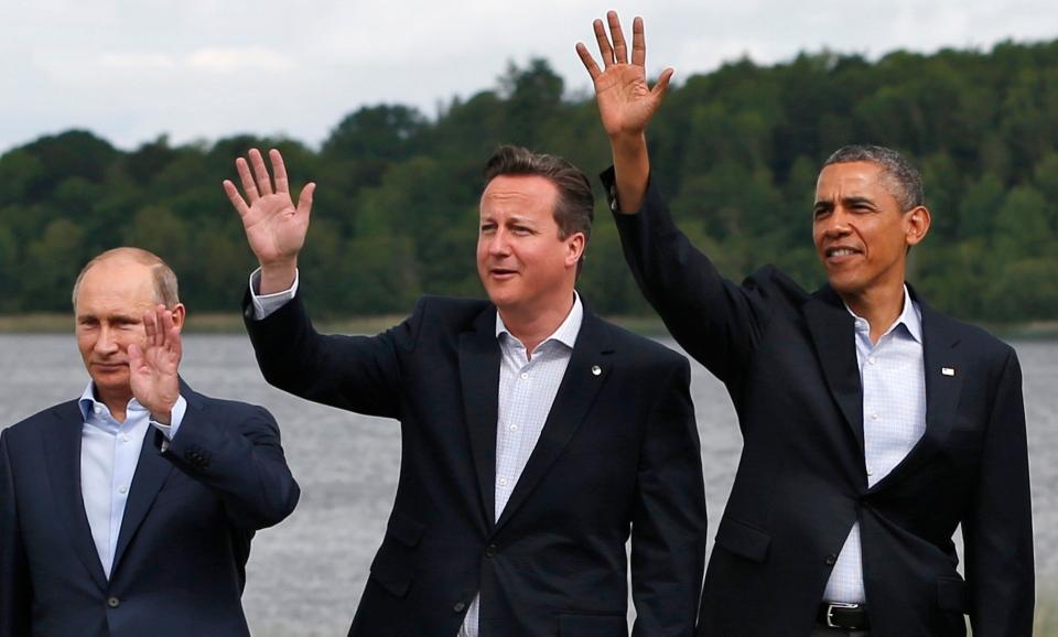 G8 leaders from left, Russian President Vladimir Putin, British Prime Minister David Cameron and US President Barack Obama at the Lough Erne golf resort in Enniskillen, Northern Ireland, on Tuesday, June 18, 2013. (AP Photo/Lefteris Pitarakis)