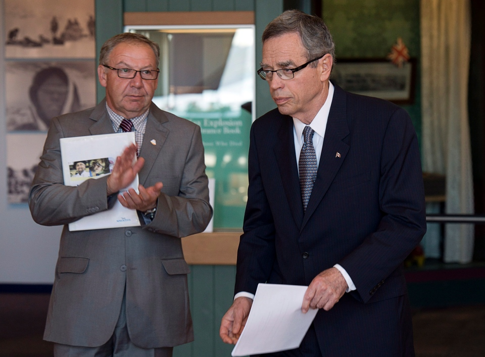Premier Darrell Dexter, left, looks on as Natural Resources Minister Joe Oliver heads to the podium at a news conference at the Maritime Museum of the Atlantic in Halifax on Tuesday, June 18, 2013. (Andrew Vaughan / THE CANADIAN PRESS)