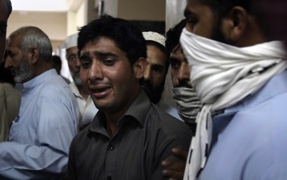 A Pakistani mourns the death of his relative, a victim of a suicide bombing, at a hospital in Mardan, Pakistan, Tuesday, June 18, 2013. (AP / Mohammad Sajjad)