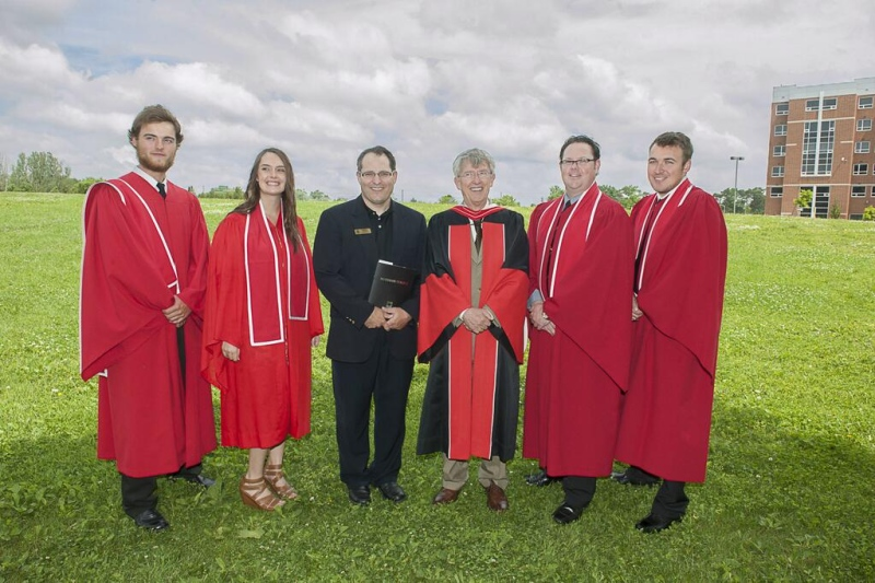 Dr. Howard Rundle, the retiring president of Fanshawe College, third from right, is seen with graduates of the Golf and Club Management program in London, Ont. on Tuesday, June 18, 2013 in this photo provided by the college.