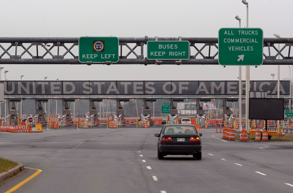 A car approaches the United States and Canada border crossing in Lacolle, Quebec, south of Montreal. (Ryan Remiorz / THE CANADIAN PRESS)