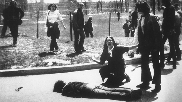 This is a May 4, 1970 file photo of Mary Ann Vecchio as she gestures and screams as she kneels by the body of a student lying face down on the campus of Kent State University, Kent, Ohio. (AP Photo/John Filo, File)