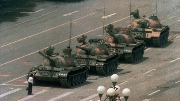 This is a June 5, 1989 file photo of a Chinese man as he stands alone to block a line of tanks heading east on Beijing's Cangan Blvd. in Tiananmen Square . (AP Photo/Jeff Widener, File)
