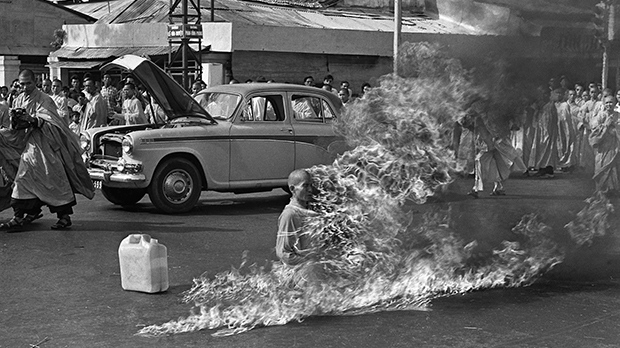 This is a June 11, 1963 file photo of Thich Quang Duc, a Buddhist monk, burns himself to death on a Saigon street South Vietnam to protest alleged persecution of Buddhists by the South Vietnamese government. (AP Photo/Malcolm Browne, File)