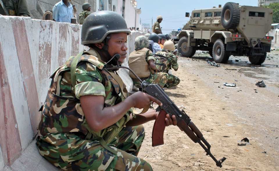 African Union peacekeepers take position outside the main U.N. compound, following an attack on it in Mogadishu, Somalia Wednesday, June 19, 2013.  (AP / Farah Abdi Warsameh)
