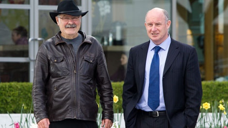 British Columbia NDP leadership candidate Mike Farnworth, right, and former B.C. premier Mike Harcourt walk to a news conference in Vancouver, B.C., on Monday April 11, 2011. Harcourt endorsed Farnworth to become the new leader of the B.C. NDP party. THE CANADIAN PRESS/Darryl Dyck