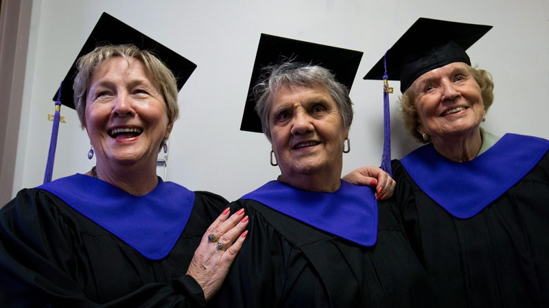 From left, Maureen Baker, 76, Adriana Peters, 80, and Cathleen Eddison, 89, wait to receive their high school diplomas during a graduation ceremony in Agassiz, B.C. June 19, 2013. (THE CANADIAN PRESS/Darryl Dyck)