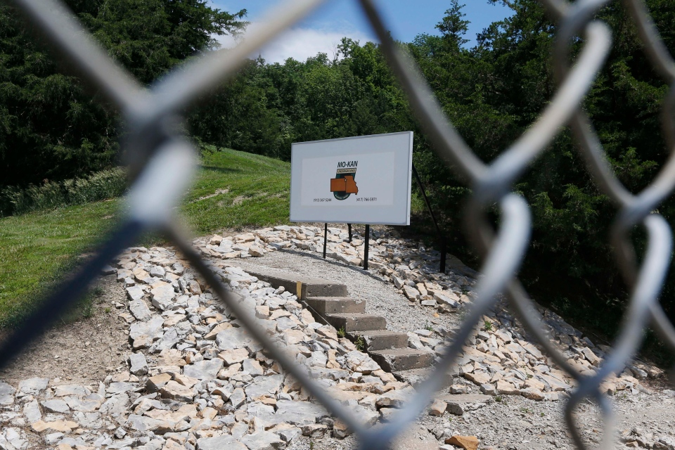 A fence helps guard the entrance to the Vivos Shelter and Resort which is part of the Mo/Kan Underground facility in Atchison, Kan., on June 18, 2013. (AP Photo/Orlin Wagner)