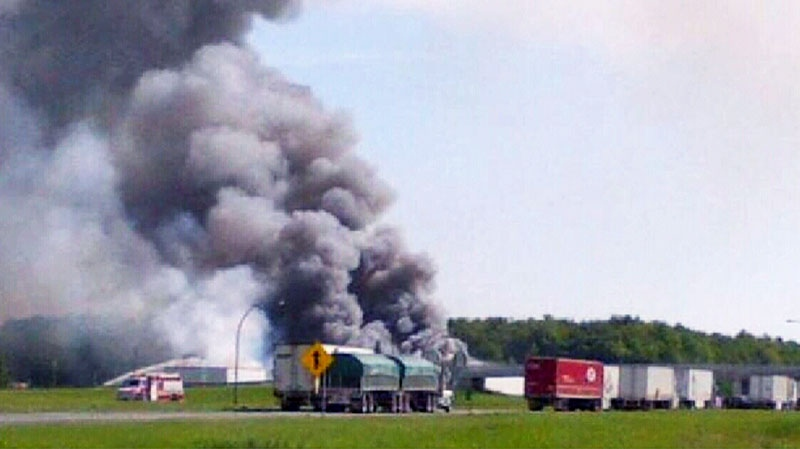 Smoke rises after an explosion at a fireworks store in Coteau du Lac, Que., Thursday, June 20, 2013.