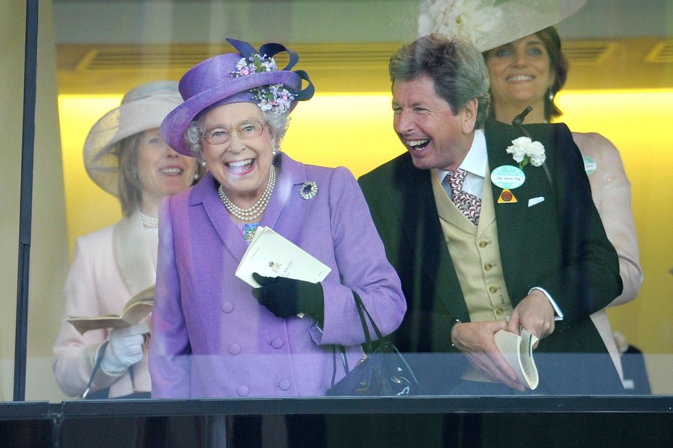 Britain's Queen Elizabeth II, with her racing manager John Warren, react after her horse, Estimate, won the Gold Cup on Day 3 of the Royal Ascot at the Ascot Racecourse in England on June 20, 2013. (AP / Tim Ireland)