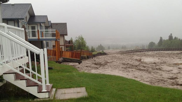 Water levels in Cougar Creek threatened homes (Photo Courtesy: Robyn Edgar)
