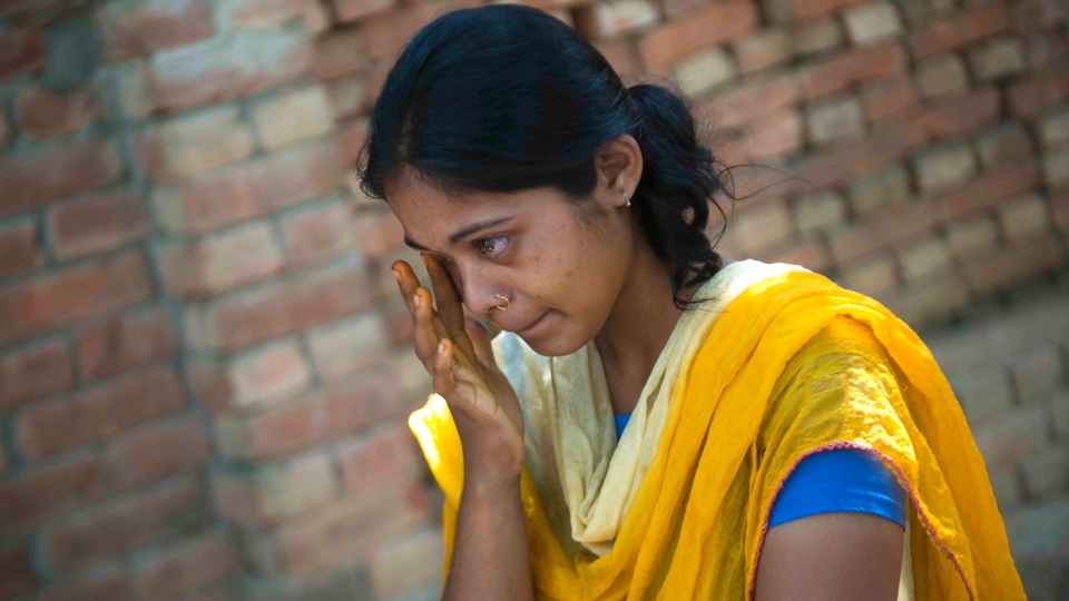 Mosammat Samira Khatun, 14, cries in Rangpur, Bangladesh for the loss of her oldest sister, Rabeya Begum Laisu, who was killed while sewing on the second floor of Rana Plaza building when it collapsed, Wednesday, May 22, 2013. (AP / Ismail Ferdous)