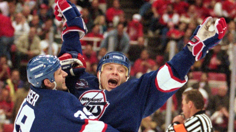 Winnipeg Jets' Iain Fraser, left, celebrates an empty net goal by teammate Alexei Zhamnov, right, against the Detroit Red Wings at Joe Louis Arena in Detroit on Friday, April 26, 1996. (AP / Tom Pidgeon)