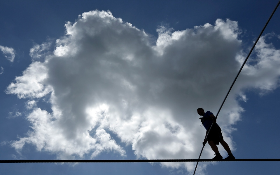 High wire performer Nik Wallenda walks across a wire as he practices in Sarasota, Fla., Tuesday, June 18, 2013. (AP / Chris O'Meara)