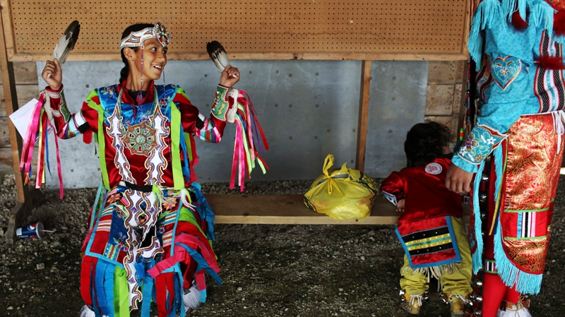 Chasin Thompson,12, of the Cree nation, wears traditional clothing during an event by Manito Abhee celebrating National Aboriginal Day in Winnipeg, Manitoba, Tuesday, June 21, 2011. (AP / Kevin Frayer)