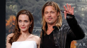 Angelina Jolie, left, and Brad Pitt wave prior to the film premiere World War Z in Berlin, Germany, Tuesday, June 4, 2013 . (AP / Frank Augstein)